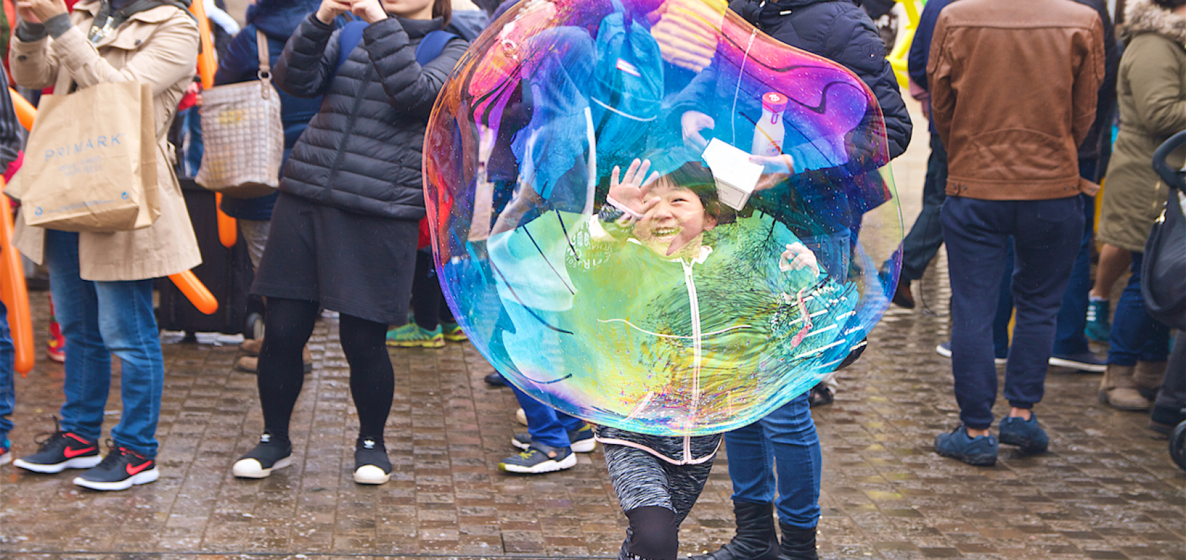 Child chasing a giant bubble