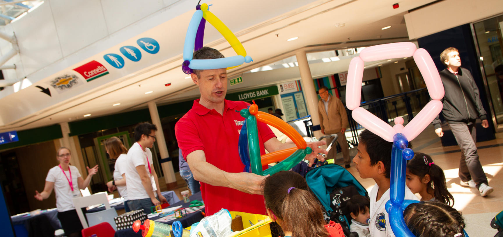 House of Maths provides mathematical balloon hats for children at the Oxford Maths Festival