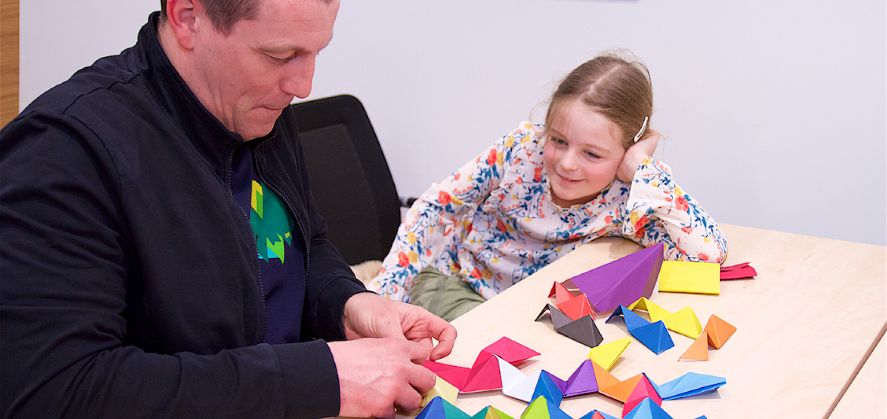 Father and daughter making a colourful dodecahedron