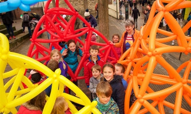 Children in a large balloon tetrahedron