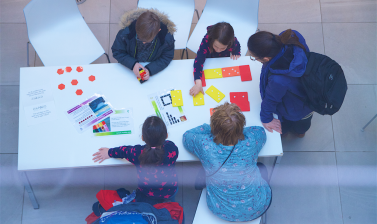View from above to mathematical activities with children around a table