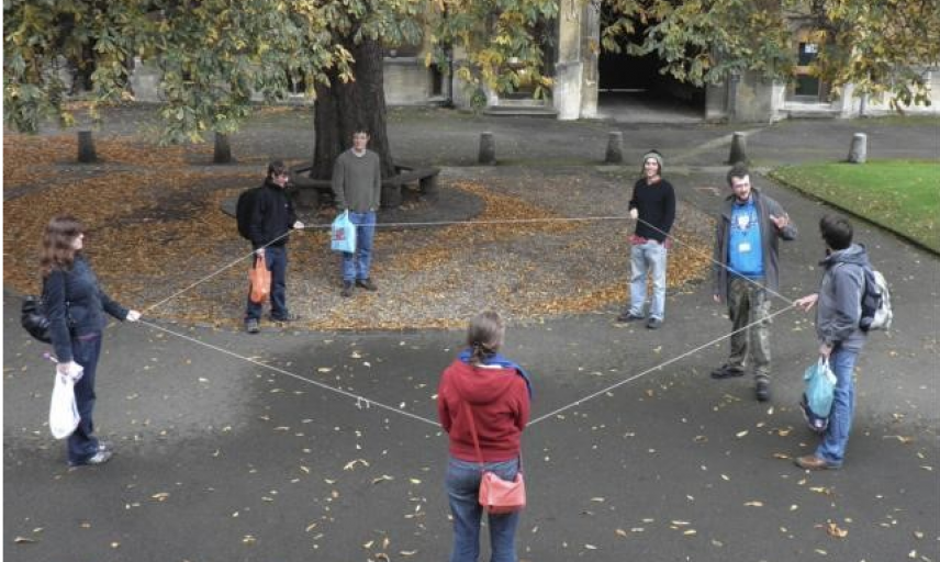 Group holding string in a hexagon shape