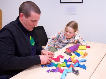 Father and daughter making mathematical craft