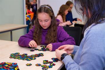Girl playing Tantrix game